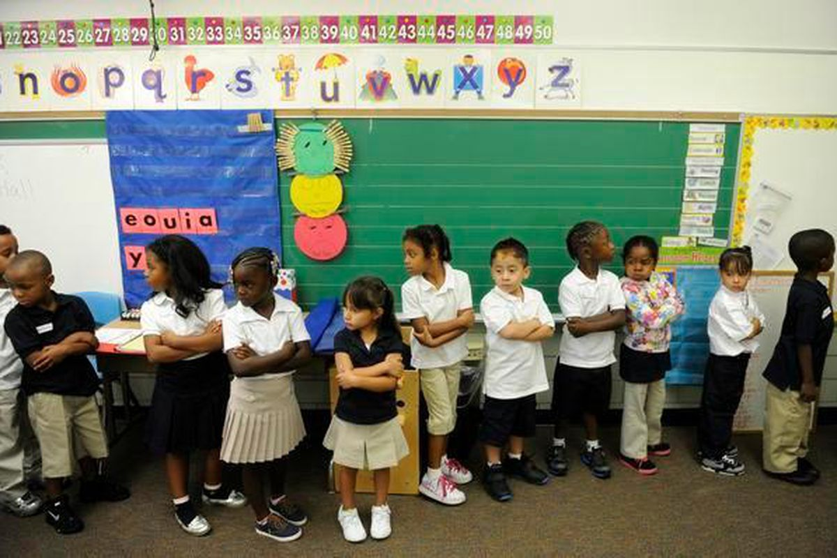 Kindergarten students line up on the first day of school in 2012 at Whittier K-8 School in Denver. (Photo by RJ Sangosti, The Denver Post)