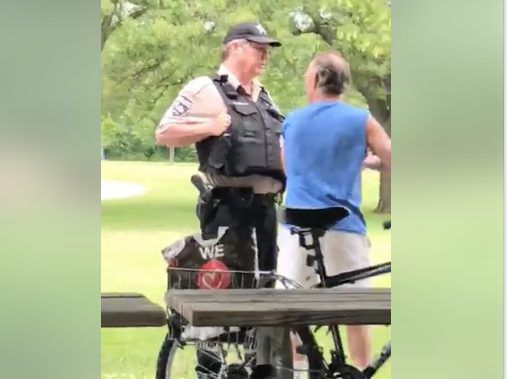 Officials identified the two men in the video as Timothy G. Trybus, right, who has been charged with assault and disorderly conduct, and Forest Preserves police officer Patrick Connor, who has been placed on desk duty during an investigation into his hand