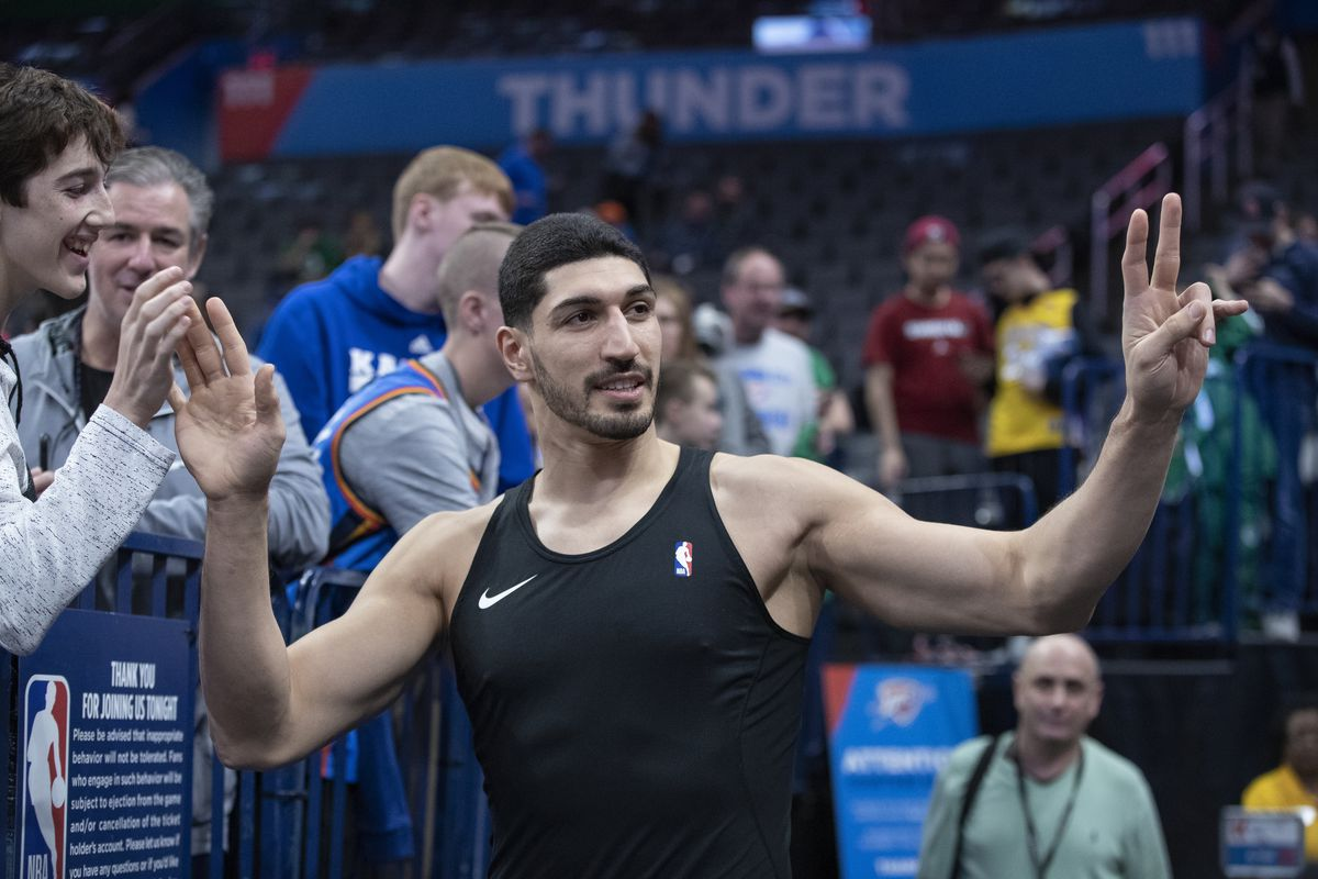 Boston Celtics center Enes Kanter waves to fans as he comes out for warm ups before a game against the Oklahoma City Thunder at Chesapeake Energy Arena.