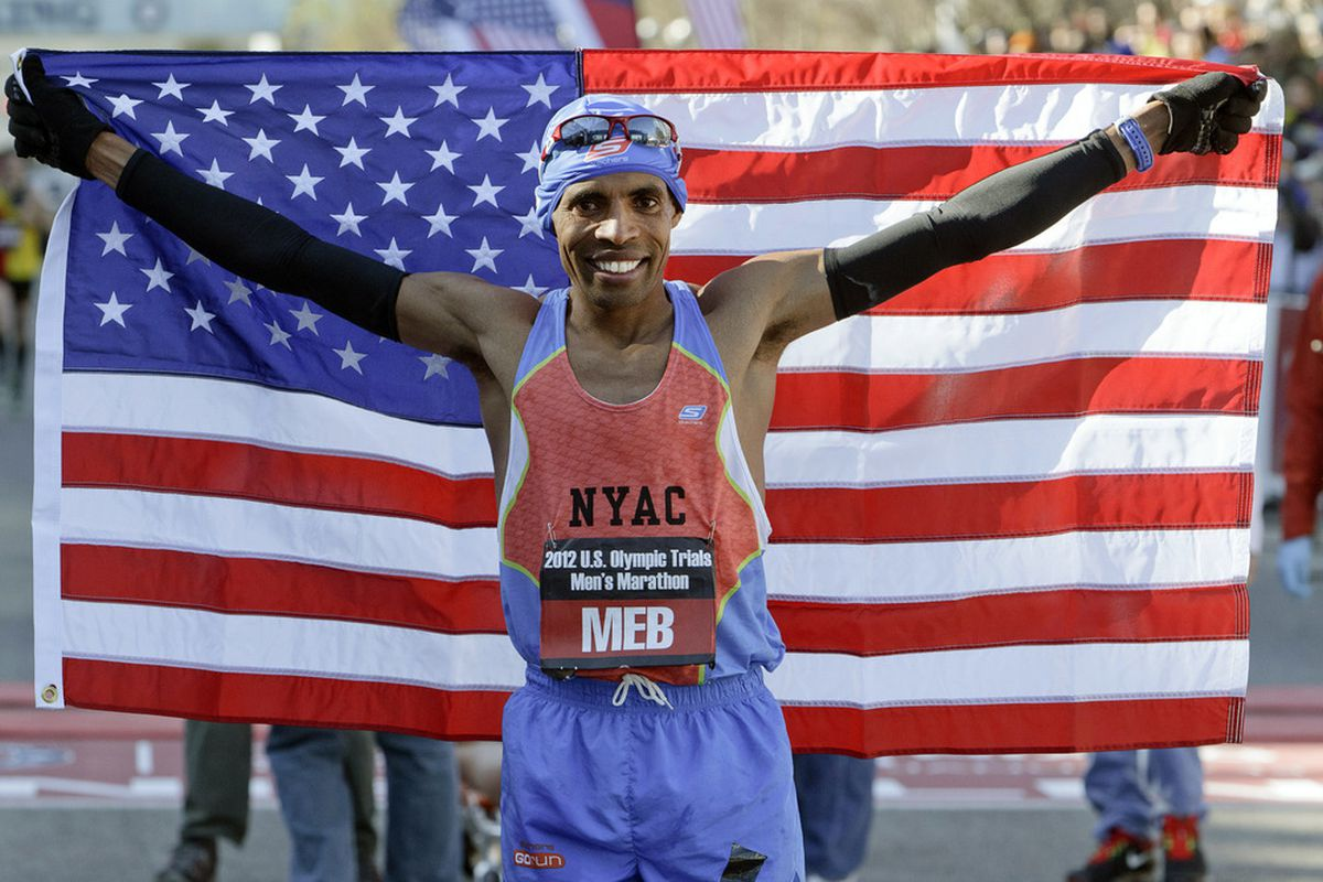 HOUSTON, TX - JANUARY 14:  Meb Keflezighi poses with the American flag after winnning the U.S. Marathon Olympic Trial in a time of 2:09:08 on January 14, 2012 in Houston, Texas.  (Photo by Bob Levey/Getty Images)