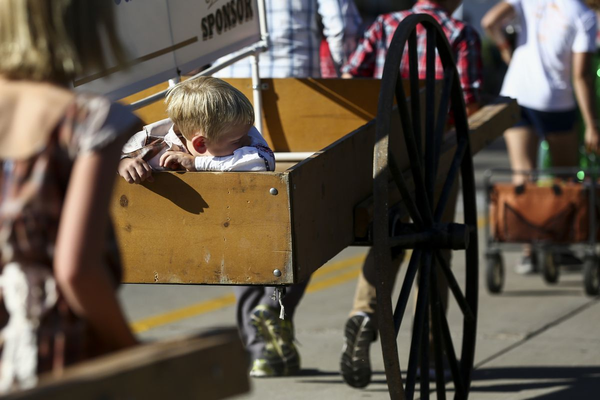 Wyatt Burnett, 6, relaxes in the back of a handcart during the Bountiful Handcart parade in Bountiful on Friday, July 19, 2019.