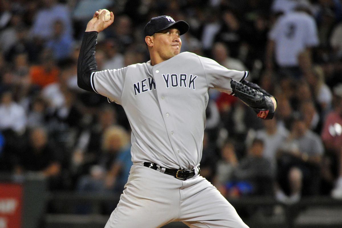 August 20, 2012; Chicago, IL, USA; New York Yankees starting pitcher Freddy Garcia (36) delivers a pitch during the third inning against the Chicago White Sox at U.S. Cellular Field.  Mandatory Credit: Rob Grabowski-US PRESSWIRE
