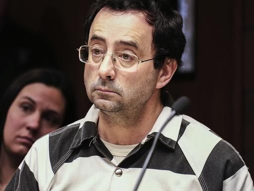FILE – In this Friday, Feb. 17, 2017, file photo, Dr. Larry Nassar listens to testimony of a witness during a preliminary hearing, in Lansing, Mich. (Robert Killips/Lansing State Journal via AP, File)