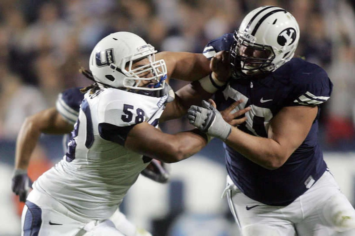 Kamaloni Vainikolo of Utah State defends the block of lineman Matt Reynolds of BYU during the second half of play in Provo Friday, October 2, 2009.
