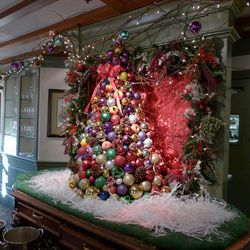 Watts works all year long to create wreaths, trees, and greenery with materials like painted crepe myrtle, faux berries, eucalyptus, faux fruits, and gilded Christmas balls. He's even used avant garde materials like lobster bodies and spray-painted flatwa