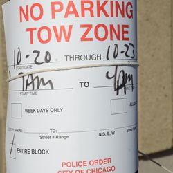 Sat 3:26 p.m. One of the no parking signs posted around the ballpark -