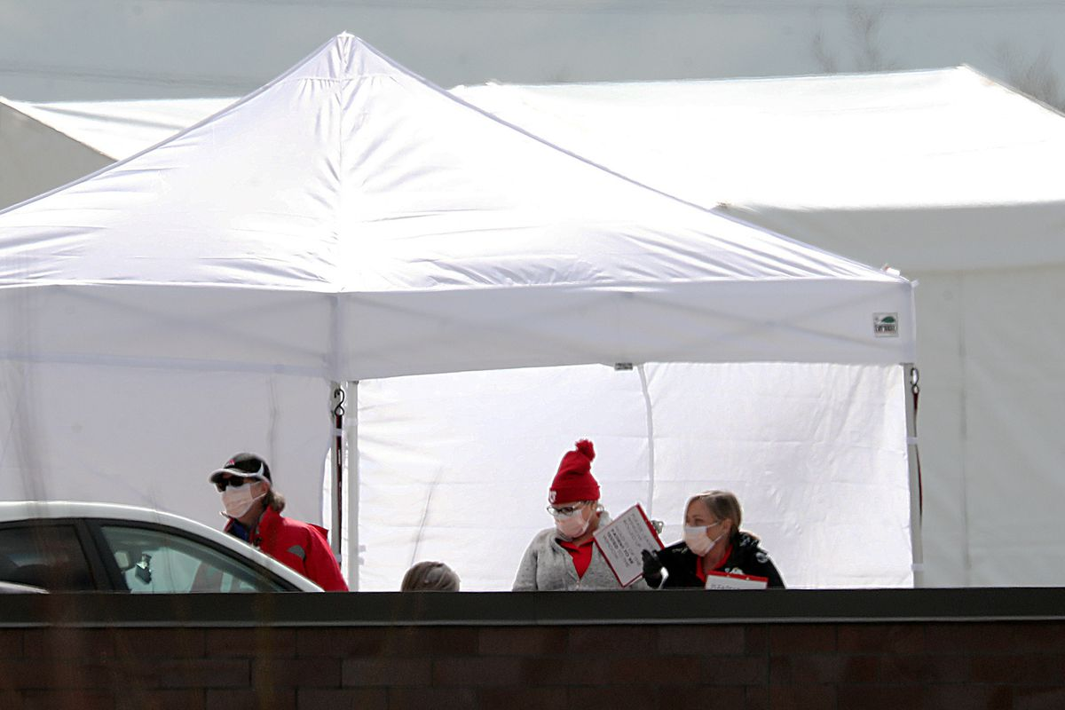 University of Utah Health employees direct people to the COVID-19 testing tents at the Sugar House Health Center in Salt Lake City on Wednesday, March 25, 2020.