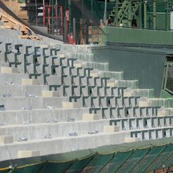 5:07 p.m. First footings for bleacher benches appear -