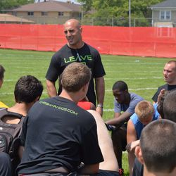 Chris Maragos (middle) talks with camp participants Saturday at William Horlick (Racine, Wis.) High School.