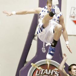 Bingham's T.J. Ford falls after a hit in Bingham's 56-38 win over Clearfield.