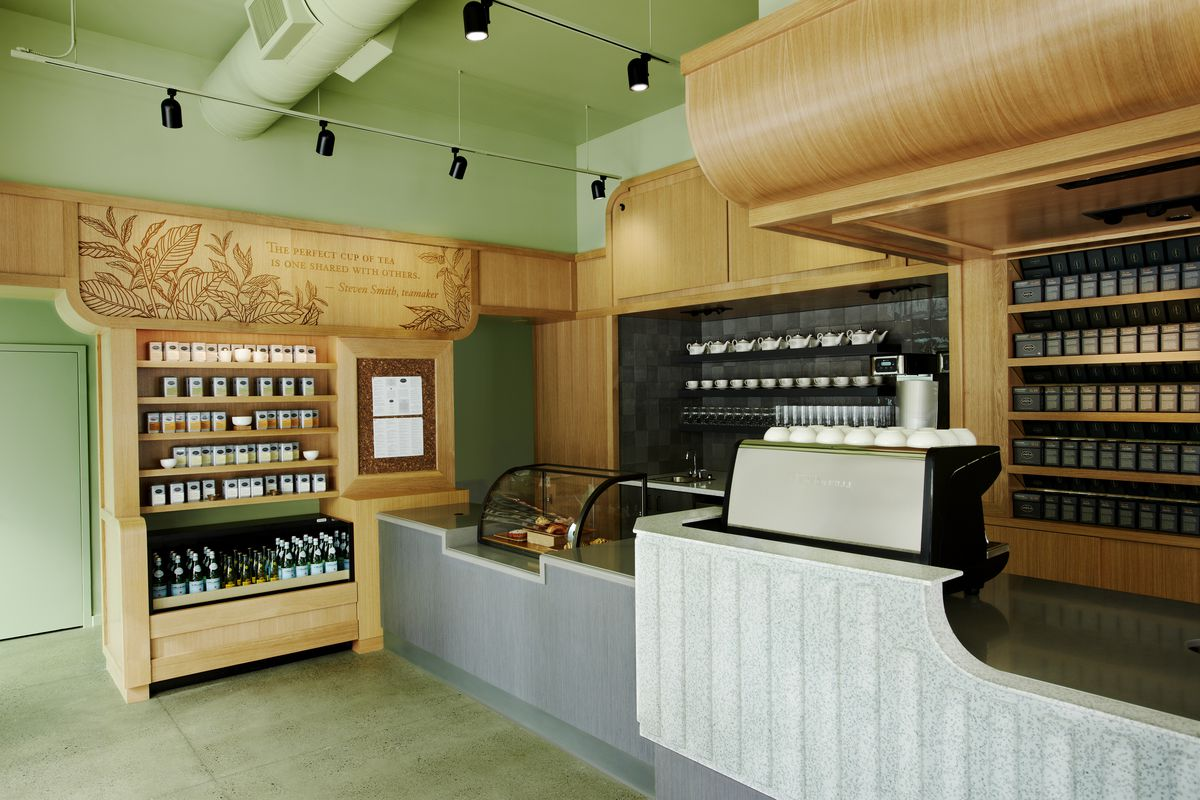 The white counter butts up against a wooden built-in with a menu and a quote from Smith.
