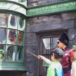 Reciting incantations with magical wands in Hogsmeade