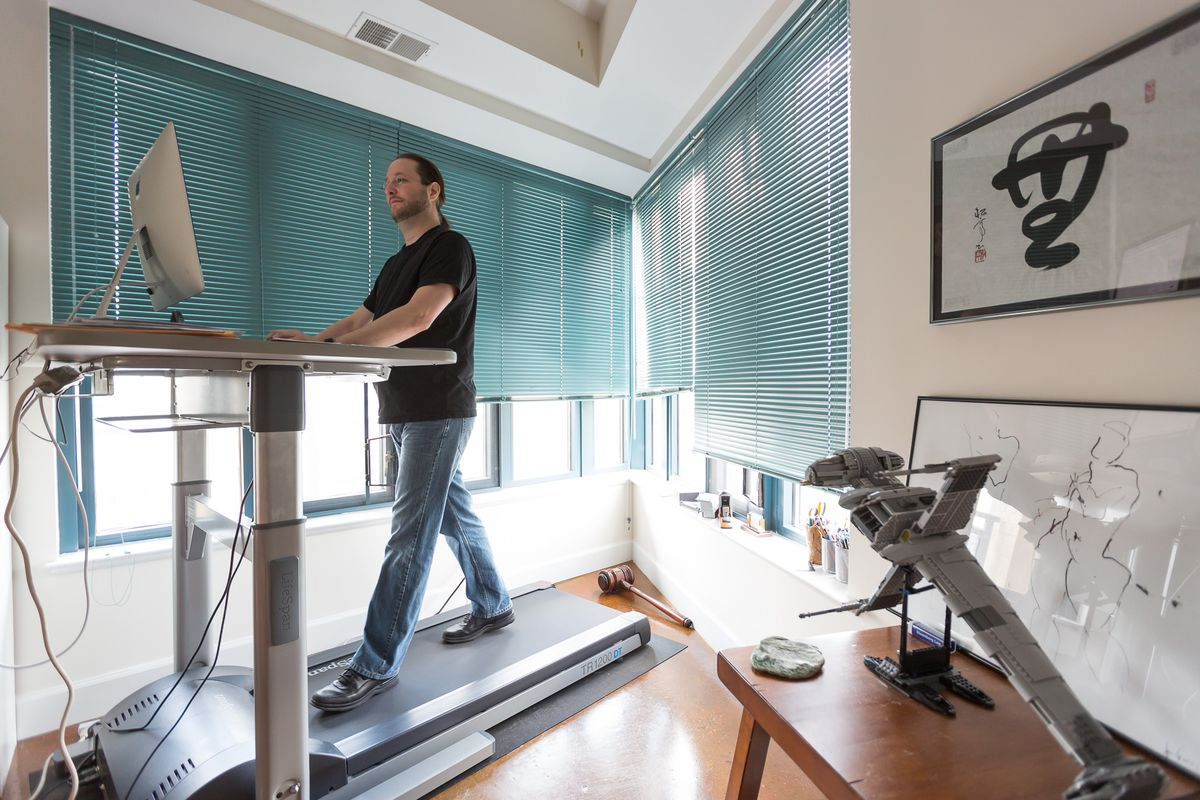 Jonathan Zucker working at his new treadmill desk.
