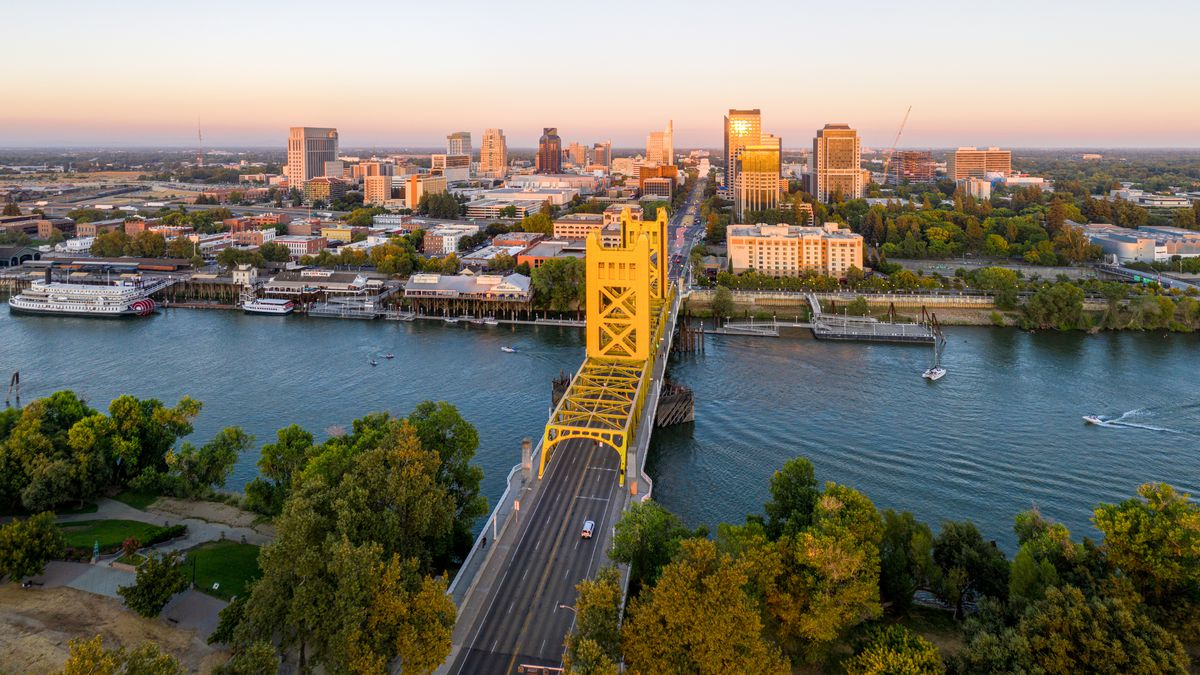 A bridge over the Sacramento River leads into the downtown of California's capital city.