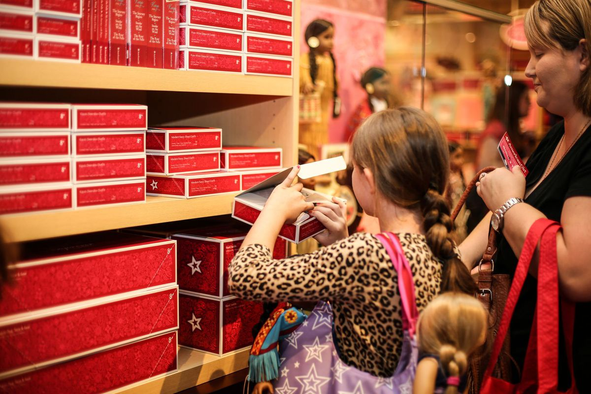 A girl and her mom at the American Girl store.