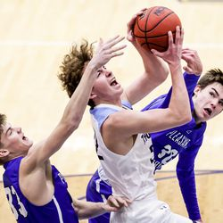 Westlake's Kaden Hoppins is fouled as he drives between Pleasant Grove's Levi Boggess and Tanner Hanks in a boys basketball game at Westlake High School in Saratoga Springs on Friday, Jan. 29, 2021.