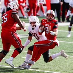 Utah Utes quarterback Jake Bentley (8) is brought down by Washington State Cougars defensive end Ron Stone Jr. (10) during an NCAA football game at Rice-Eccles Stadium in Salt Lake City on Saturday, Dec. 19, 2020.