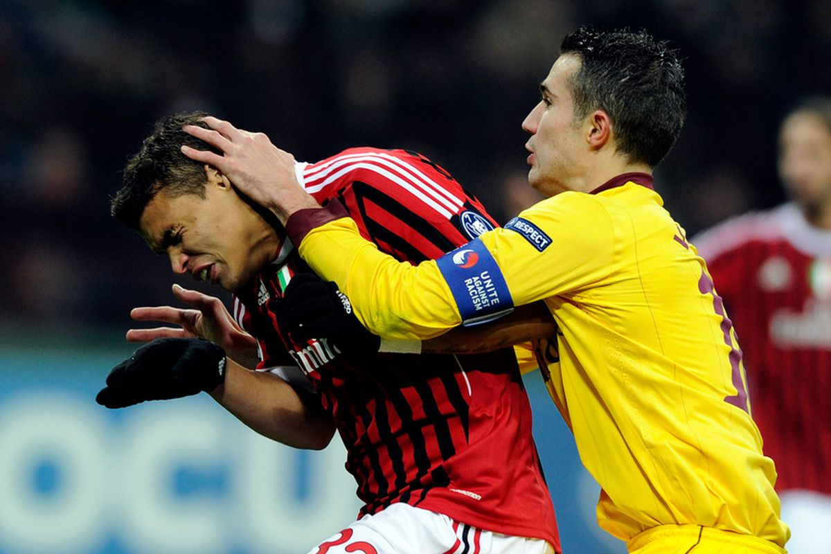 this is a picture of Robin van Persie and Thiago Silva (and possibly an out-of-focus Zlatan Ibrahimovic)