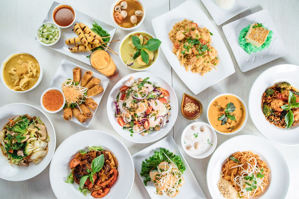 A spread of Thai noodle dishes and curries