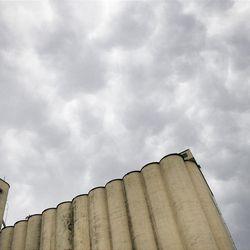 Turbulent clouds move across the sky above a grain elevator near Salina Kan., Saturday, April 14, 2012. (AP Photo/Orlin Wagner)