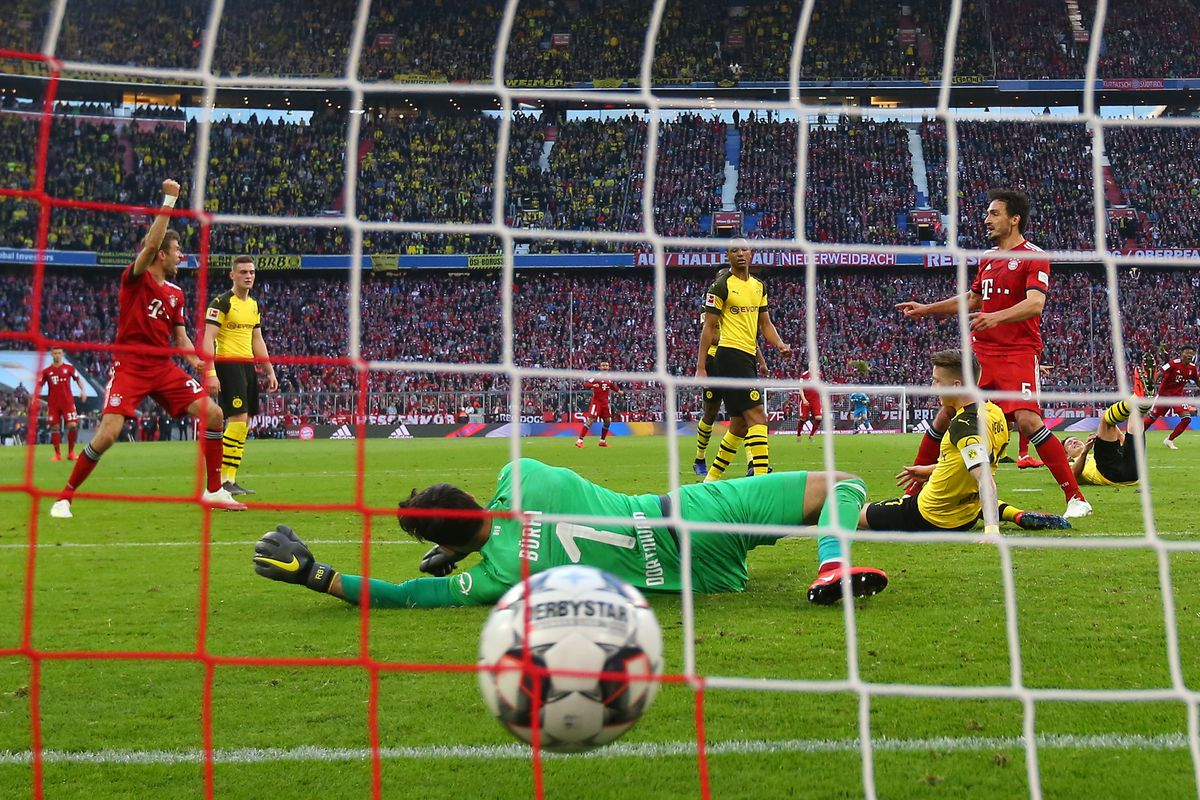MUNICH, GERMANY - APRIL 06: Javier Martinez of Bayern Munich (obscured) scores his team's third goal past Roman Buerki of Borussia Dortmund during the Bundesliga match between FC Bayern Muenchen and Borussia Dortmund at Allianz Arena on April 06, 2019 in Munich, Germany.