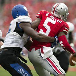 Buffalo Bulls linebacker Khalil Mack (46) tackles Ohio State Buckeyes quarterback Braxton Miller (5) at Ohio Stadium. Ohio State won the game 40-20