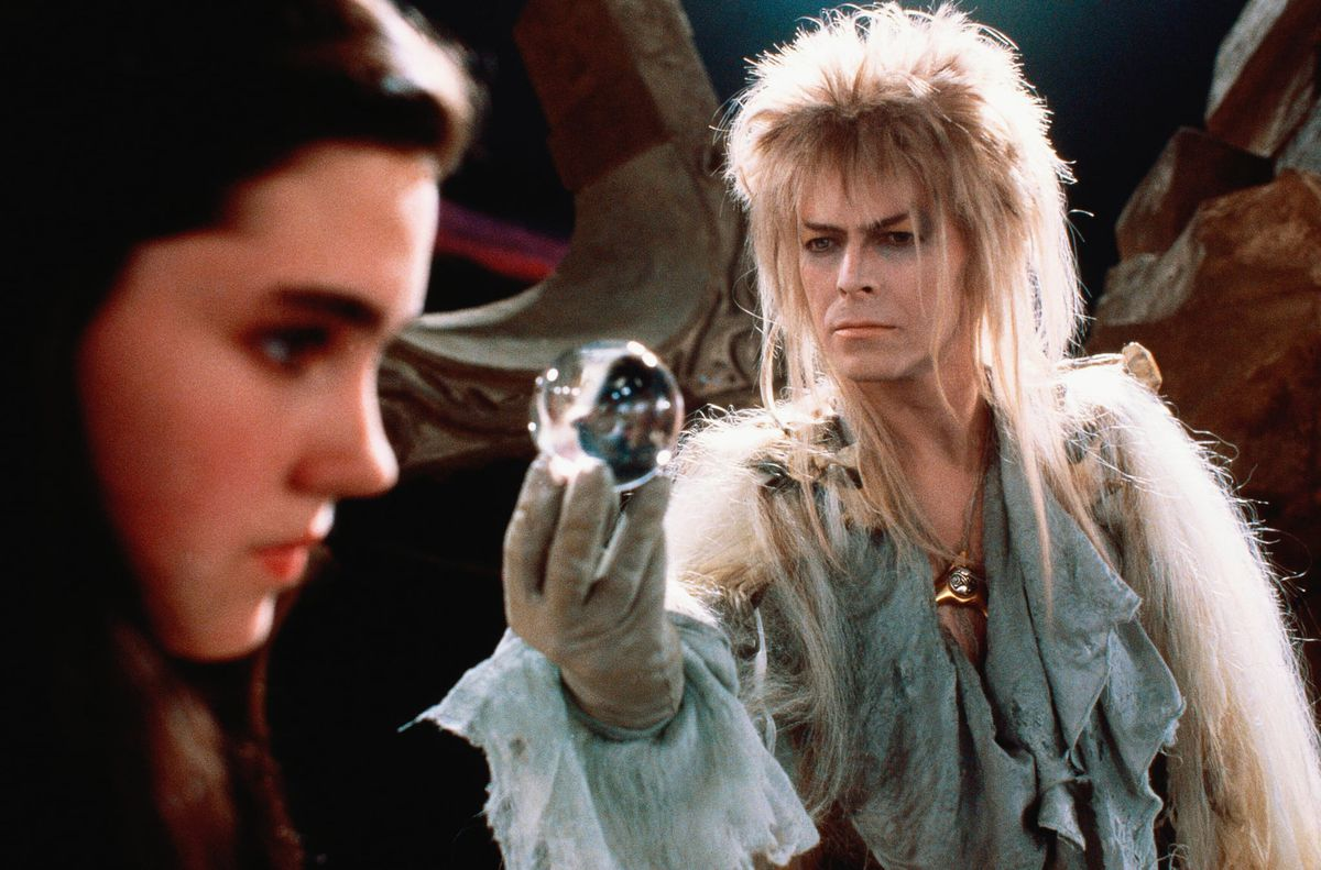 David Bowie as Jareth in Labyrinth offers a glass ball to Jennifer Connelly as Sarah