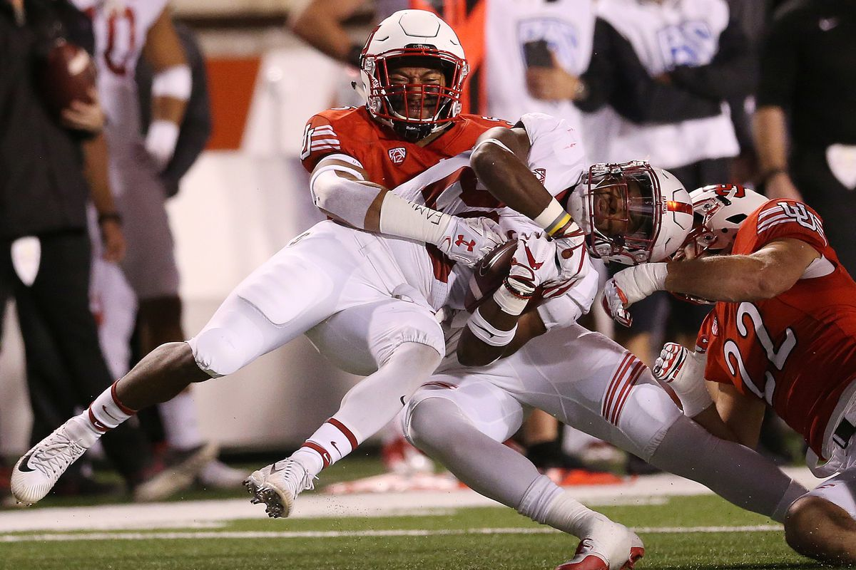 Utah linebacker Kavika Luafatasaga tackles Stanford running back Bryce Love in Salt Lake City on Saturday, Oct. 7, 2017. The two teams meet again Saturday at Stanford, but the status of Love for that game, who is nursing an injured ankle, is up in the air