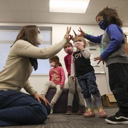 Salt Lake City Mayor Erin Mendenhall visits with preschool children at Neighborhood House in Salt Lake City on Tuesday, Dec. 22, 2020.Mendenhall was there to help distribute food via the Nourish to Flourish program.