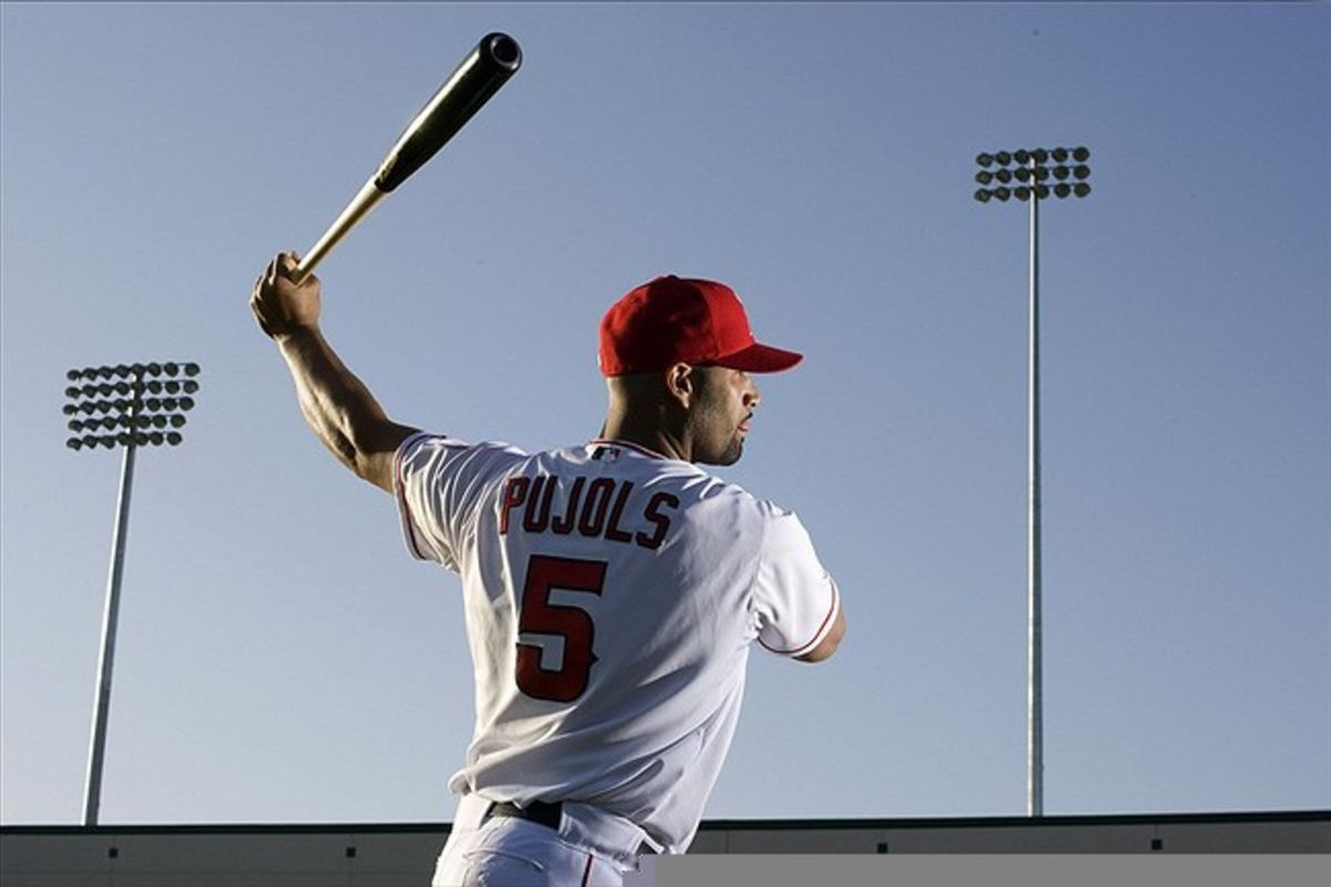 Feb 29, 2012; Tempe, AZ, USA; Los Angeles Angels first baseman Albert Pujols (5) during photo day at Tempe Diablo Stadium.  Mandatory Credit: Jake Roth-US PRESSWIRE