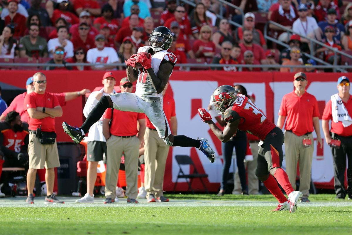Atlanta Falcons wide receiver Julio Jones catches the ball over Tampa Bay Buccaneers free safety Isaiah Johnson during the second half at Raymond James Stadium.