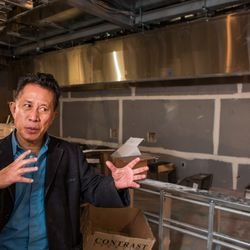Yan explains the kitchen layout: six live fire woks and a hand-pulled noodle station.