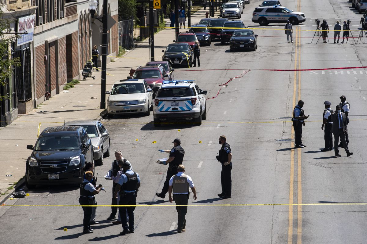 Chicago police investigate in the 300 block of North Central Avenue after a 9-year-old boy and his 27-year-old mother were shot Wednesday afternoon, Aug. 19, 2020.