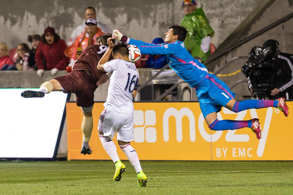 Dakota Collins (number 9) challenges for a header during a 2014 friendly with Real Salt Lake