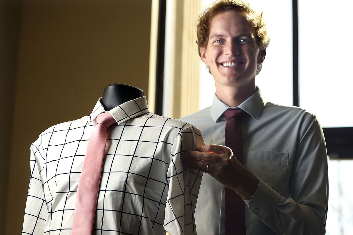Ben Perkins, owner of &Collar, holds a men's dress shirt that is made out of recycled plastic at &Collar in Salt Lake City on Thursday, April 8, 2021.
