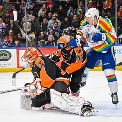 Syracuse Crunch Alexey Lipanov (36) battles for position with Lehigh Valley Phantoms Nate Prosser (39) and goalie Kirill Ustimenko (72) in American Hockey League (AHL) action at the Upstate Medical University Arena in Syracuse, New York on Saturday, February 22, 2020. Syracuse won 2-1.