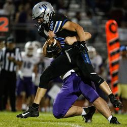 Stansbury's Bridger Thomas (10) gets pressed by Tooele's defense during a high school football gameat Stansbury High School in Stansbury Park on Friday, Sept. 17, 2021.