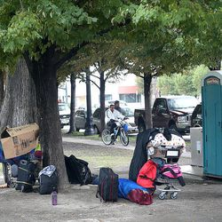 Homeless people have to keep their belongings with them in Salt Lake City's Pioneer Park on Thursday, Oct. 10, 2013. Some would appreciate a locker system where they could store their belongings during the day.