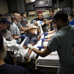 A man suffering from a stab wound is transferred from a gurney for treatment in the Emergency Department at Mount Sinai Hospital, Tuesday evening, Sept. 10, 2019.