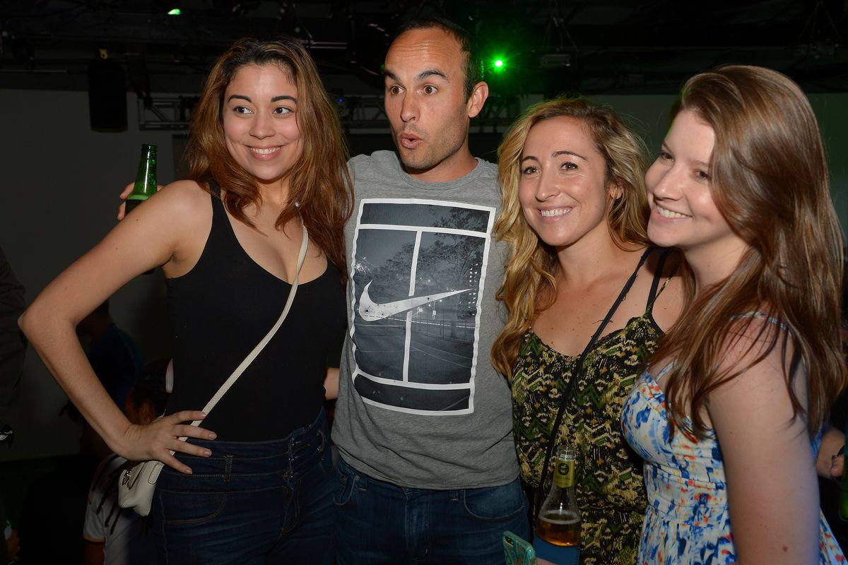 This is Landon Donovan with girls. There were no other relevant pictures available for this article. I'm happy with this because look at that face.