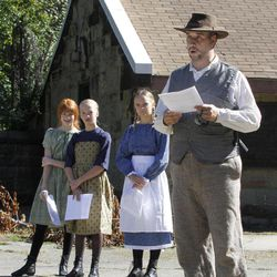 In this photo made on Tuesday, Sept. 11, 2012, Stephen Moles, right, a Civil War re-enactor, portrays Alexander McBride during a rehearsal with three teenage students taking part in a dramatic reading in front of the old powder magazine building in Arsenal Park in Pittsburgh. The reading is part of a planned day of memorial services scheduled for Sunday, Sept. 16, 2012, in recognition of the Sept. 17th anniversary of what is thought to be the largest loss of civilian life on a single day in the Civil War. Moles is portraying Alexander McBride, the superintendent of the laboratory at the Allegheny Arsenal in 1862 when, on the afternoon of Sept. 17, a series of explosions ripped through the buildings where cartridges for union soldiers were being assembled, killing 78 people, mostly teenage girls who worked there.