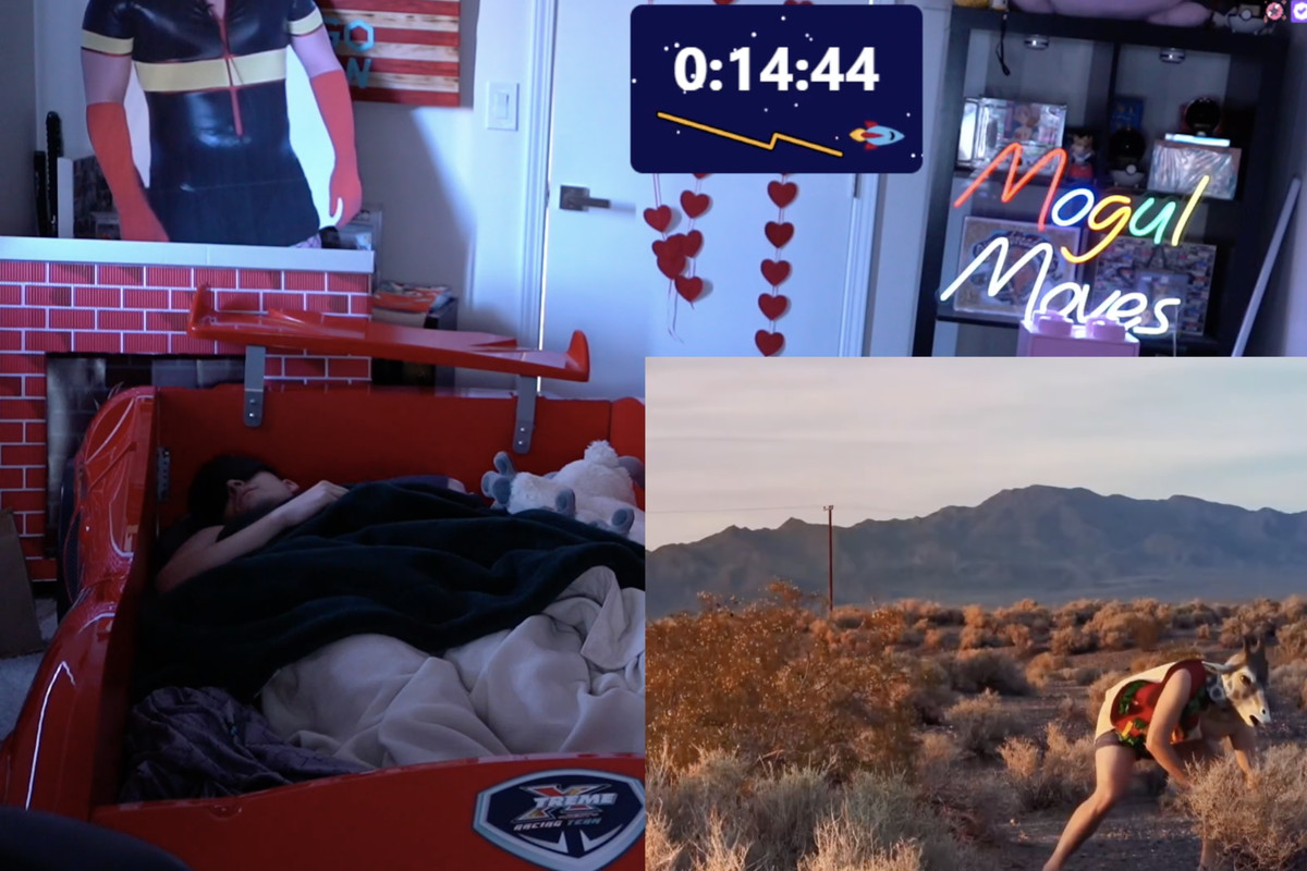 An adult man sleeping in a red racer bed. There's an overlay of a video, which shows a person wearing a giraffe mask digging in the dirt.