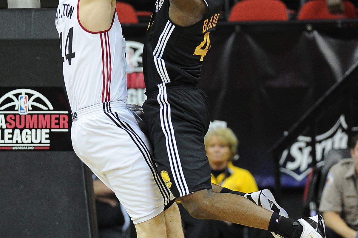 July 18, 2012; Las Vegas, NV, USA;   Miami Heat center Justin Hamilton (44) blocks a shot by Golden State Warriors forward Harrison Barnes (40) during the game at the Thomas and Mack Center.  Mandatory Credit: Jayne Kamin-Oncea-US PRESSWIRE