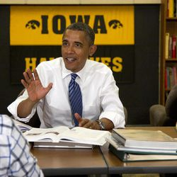 President Barack Obama participates in a roundtable discussion with students at the University of Iowa, Wednesday, April 25, 2012, in Iowa City, Iowa. at right is Myranda Burnett, and left is Martin Lopez.