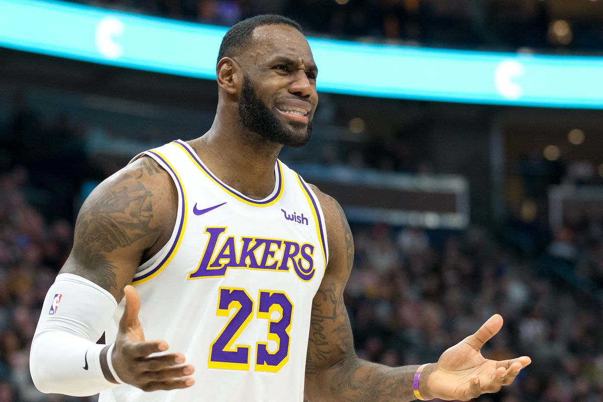 Los Angeles Lakers forward LeBron James reacts during the first half against the Utah Jazz at Vivint Smart Home Arena.
