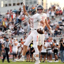 Skyridge's Mitch Adamson celebrates a touchdown with teammates as they play Orem in a high school football game in Lehi on Friday, Aug. 28, 2020.