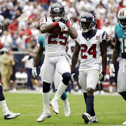 Houston Texans cornerback Kareem Jackson (25) celebrates after intercepting a pass against the Miami Dolphins in the second quarter of an NFL football game, Sunday, Sept. 9, 2012, in Houston.