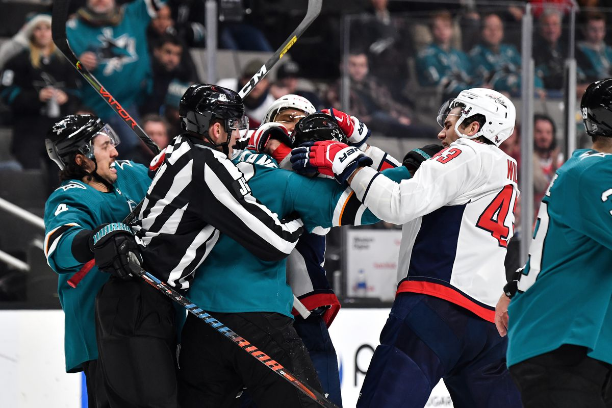 Evander Kane #9 and Brenden Dillon #4 of the San Jose Sharks fight against Alex Ovechkin #8 and Tom Wilson #43 of the Washington Capitals at SAP Center on December 3, 2019 in San Jose, California.
