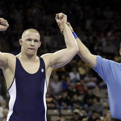 Jake Varner, of State College, Penn., reacts after beating Tommy Rowlands, of Hilliard, Ohio, in their 96 kg freestyle finals match at the U.S. Olympic Wrestling Team Trials, Saturday, April 21, 2012, in Iowa City, Iowa.
