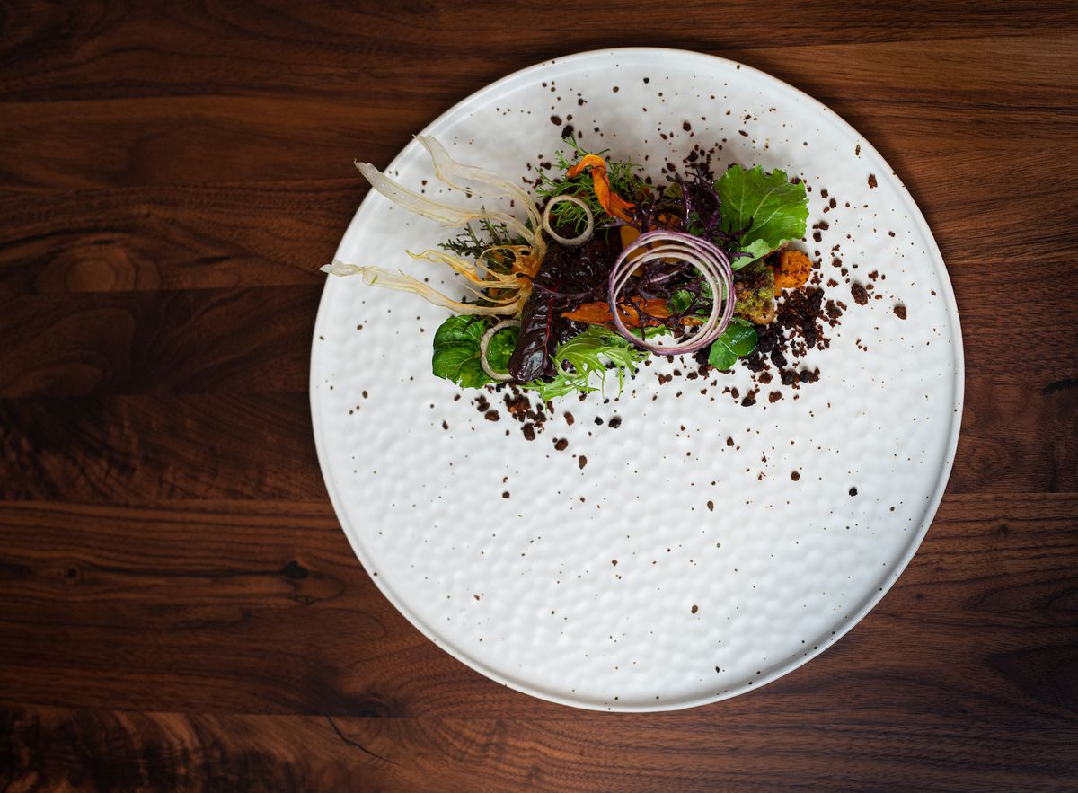 A salad placed on a white ceramic plate